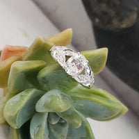 Platinum oval cut diamond estate ring