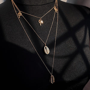 THE COWRIE LAYERED NECKLACE