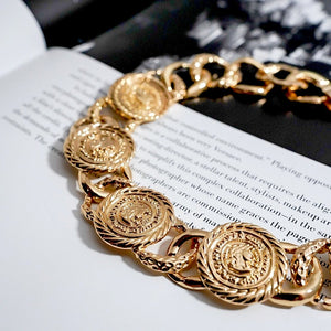 THE GOLD KRONA NECKLACE