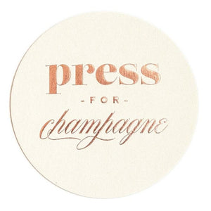 Press for champagne paper coasters available at Uncommon Party Co.