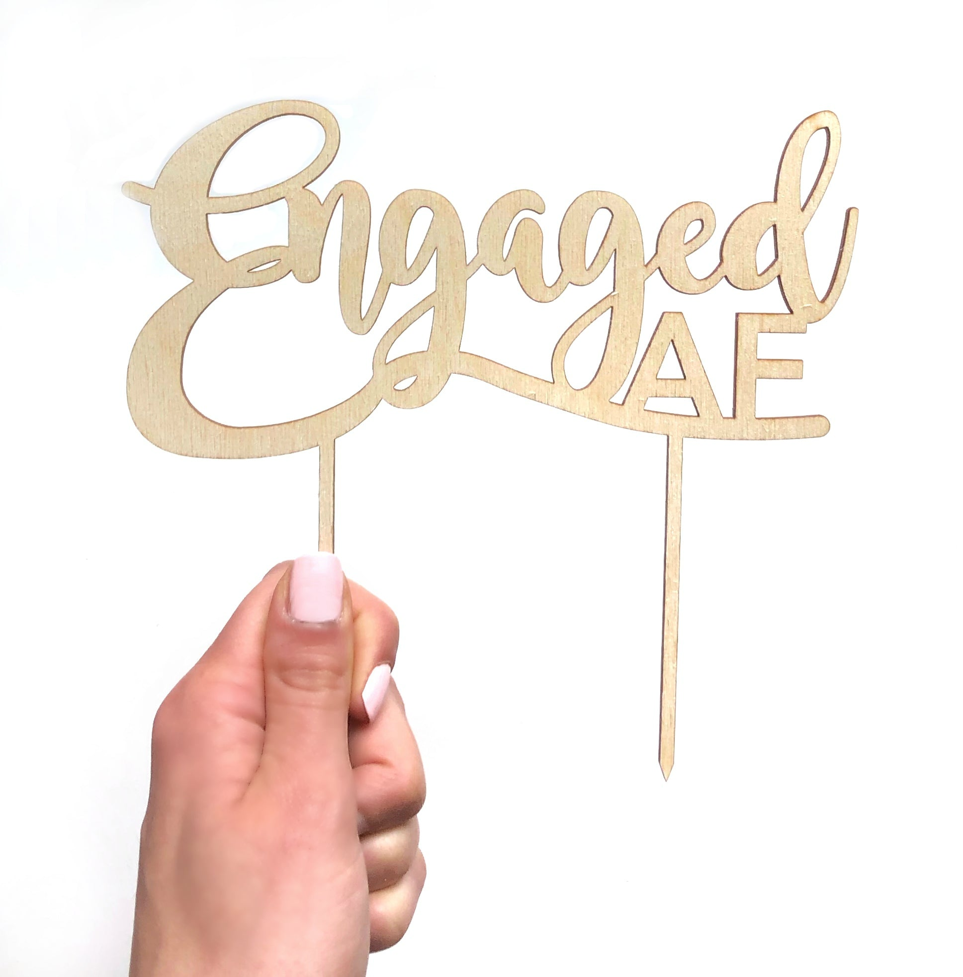 Engaged AF wood engagement cake topper.