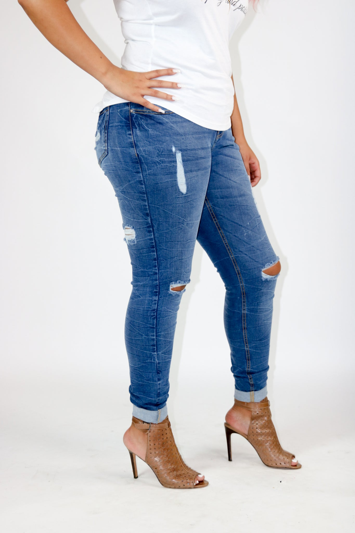 Butt lifting ripped jeans