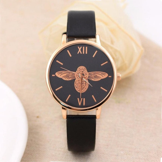 Elegant watch with gold honeybee motive