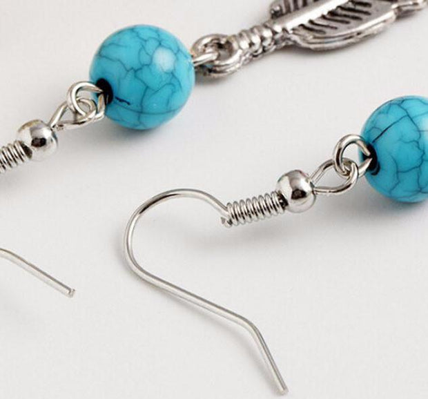 Turquoise Circular bead with dangling leaves earrings