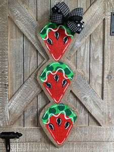 red and green watermelon slice door hanger with black bow