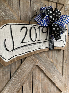 royal blue graduation diploma door hanger with blue and black bow