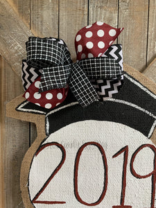 graduation cap door hanger with maroon and black bow