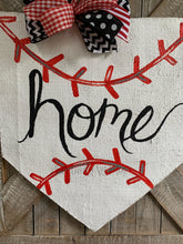 Load image into Gallery viewer, baseball home plate door hanger with hand-lettered home and black and red bow