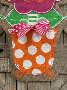 pink and orange whimsical burlap flower door hanger in orange and white polka dot flowerpot