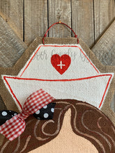 Load image into Gallery viewer, nurse door hanger with nurse hat and red and black bow