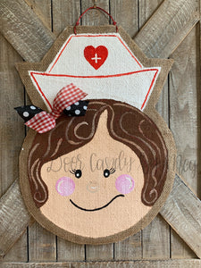 nurse door hanger with nurse hat and red and black bow