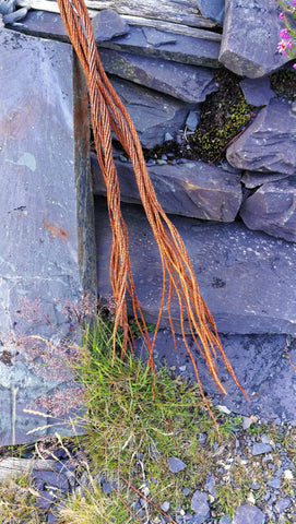 Wales, Llanberis, Dinorwic quarry - the remains of old quarry equipment, old rusty steel cable