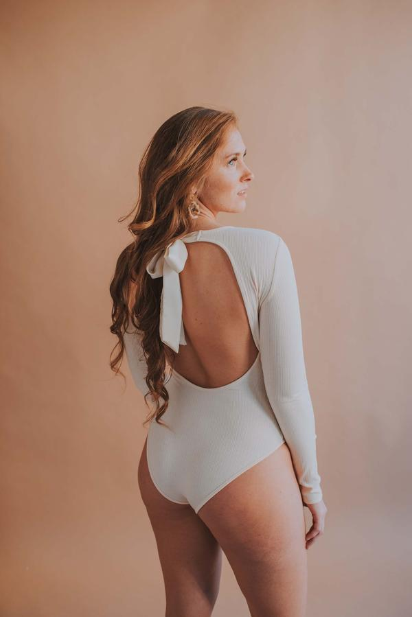 Long Sleeve Open Back Satin Tie Bodysuit In Cream - Phoebe Jane
