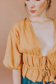 Storia - Short Sleeve Wrap Up Plunging V-Neck Top In Mustard - Phoebe Jane