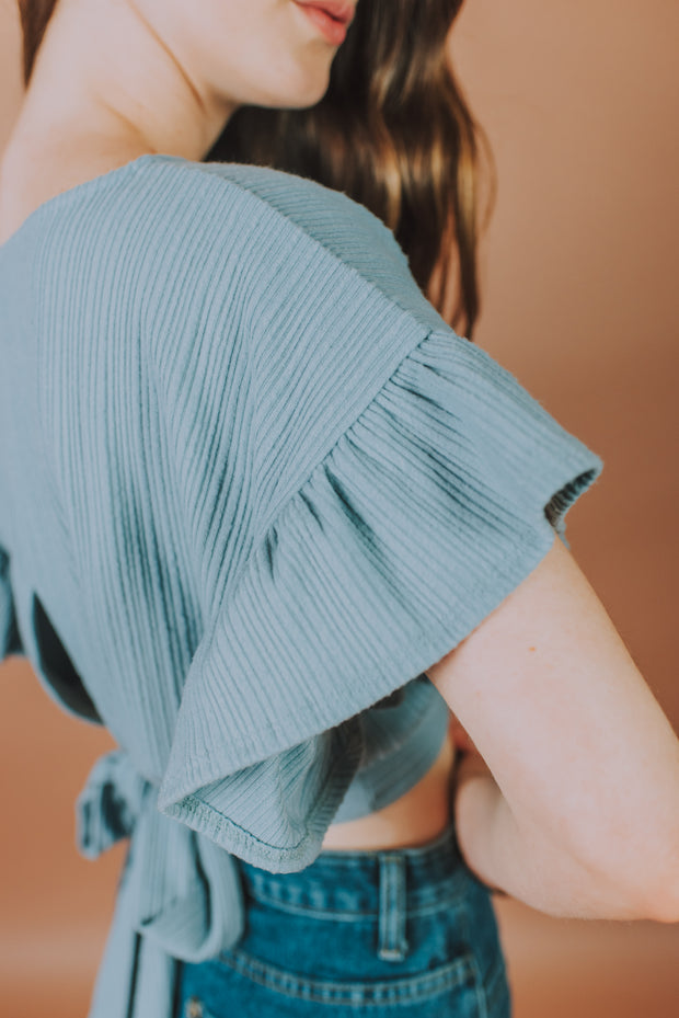 Storia - Crop Top With Ruffled Sleeves And Back Waist Tie Detailing In Dusty Blue - Phoebe Jane