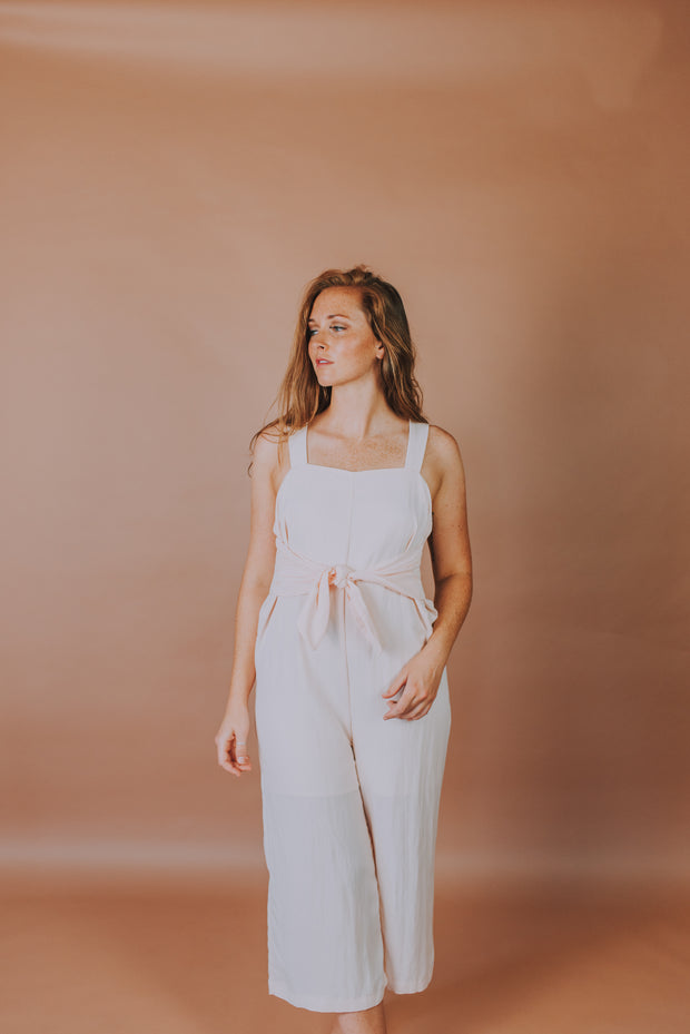 Sleeveless Woven Jumpsuit With Front Tie Detailing In Peach - Phoebe Jane