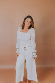Woven Pant With Front Tie Belt and Side Zipper Detailing In Cream - Phoebe Jane