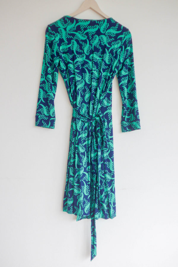 Printed stretch jersey wrap dress