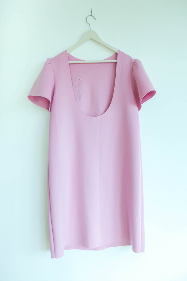 Pink neoprene dress with appliqués