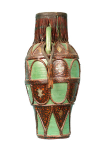Antique Moroccan ceramic vase with leather details