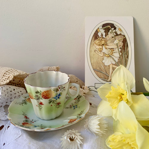 Pretty vintage hand painted miniature tea cup & saucer