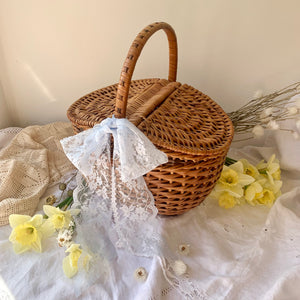 Vintage wicker picnic style lidded basket