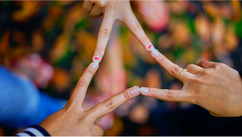 An image of three people two fingers as a sign on connection for World Suicide Prevention day