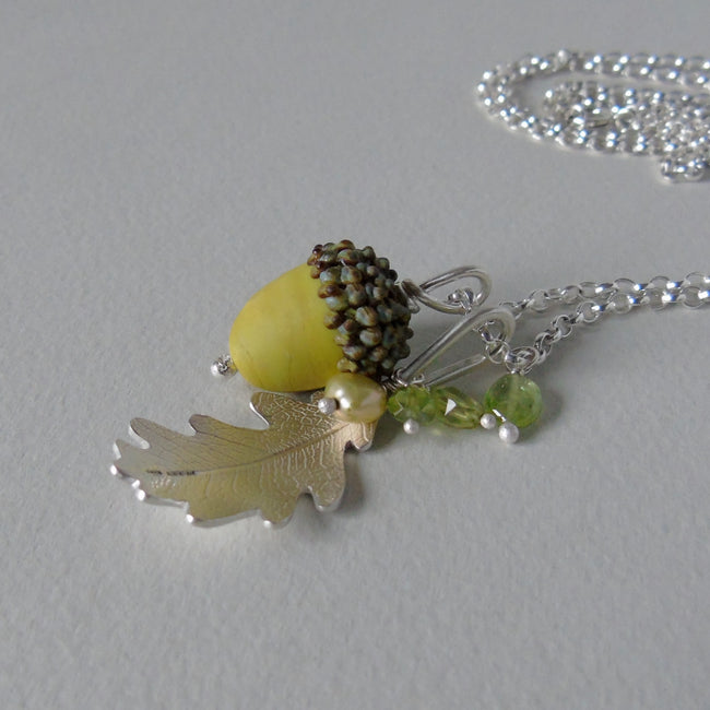 large silver oak leaf and green glass acorn necklace