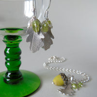 silver oak leaf and green peridot earrings