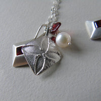 silver pointed quatrefoil and garnet necklace