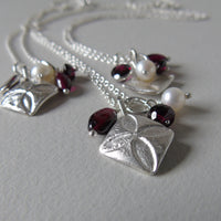 small silver pointed quatrefoil and garnet necklace