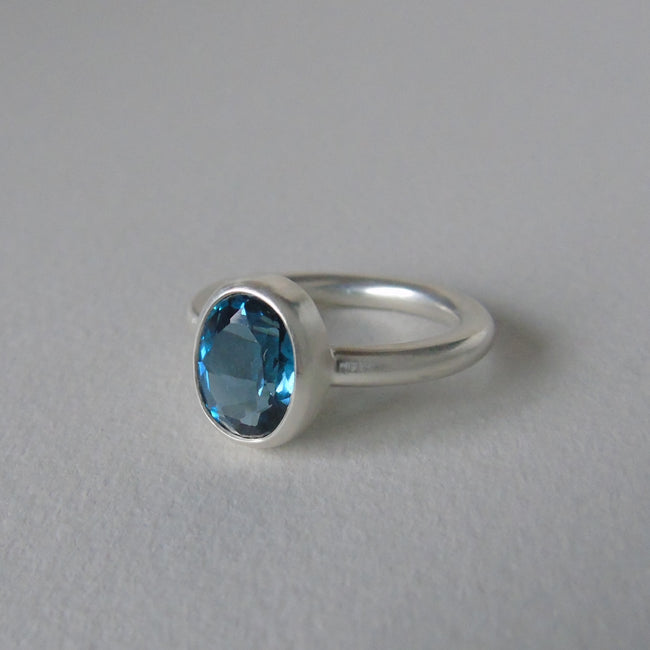 silver ring with London blue topaz