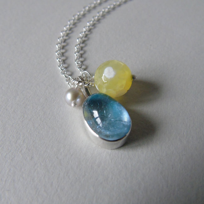 silver sunshine blue sky necklace