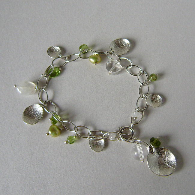 silver leaf and peridot charm bracelet