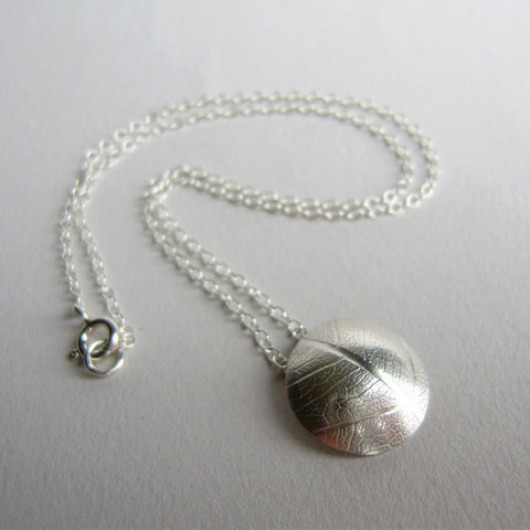 silver convex leaf necklace