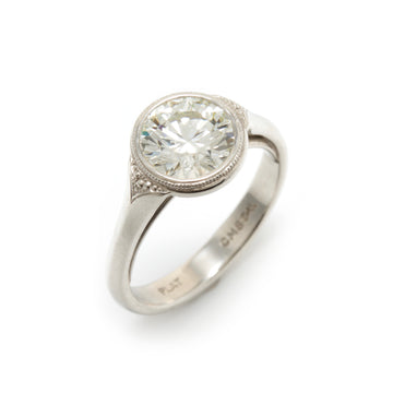 Round Brilliant Lunette Style Platinum Ring