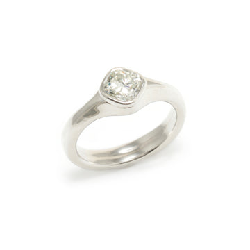 Carved Platinum Ring with Cushion Cut Diamond