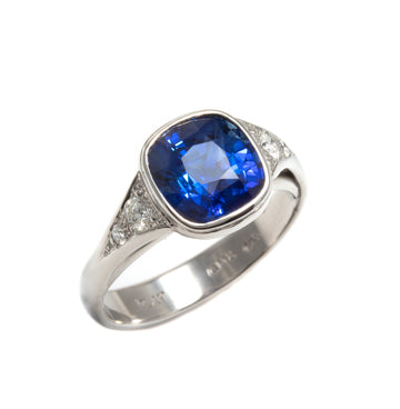 Cushion Cut Blue Sapphire Lunette Style Ring in Platinum