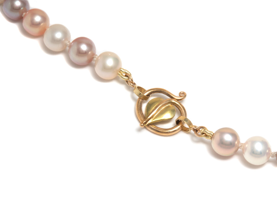 Strand of Multi-Colored Pink Freshwater Pearls with Forged Leaf Clasp