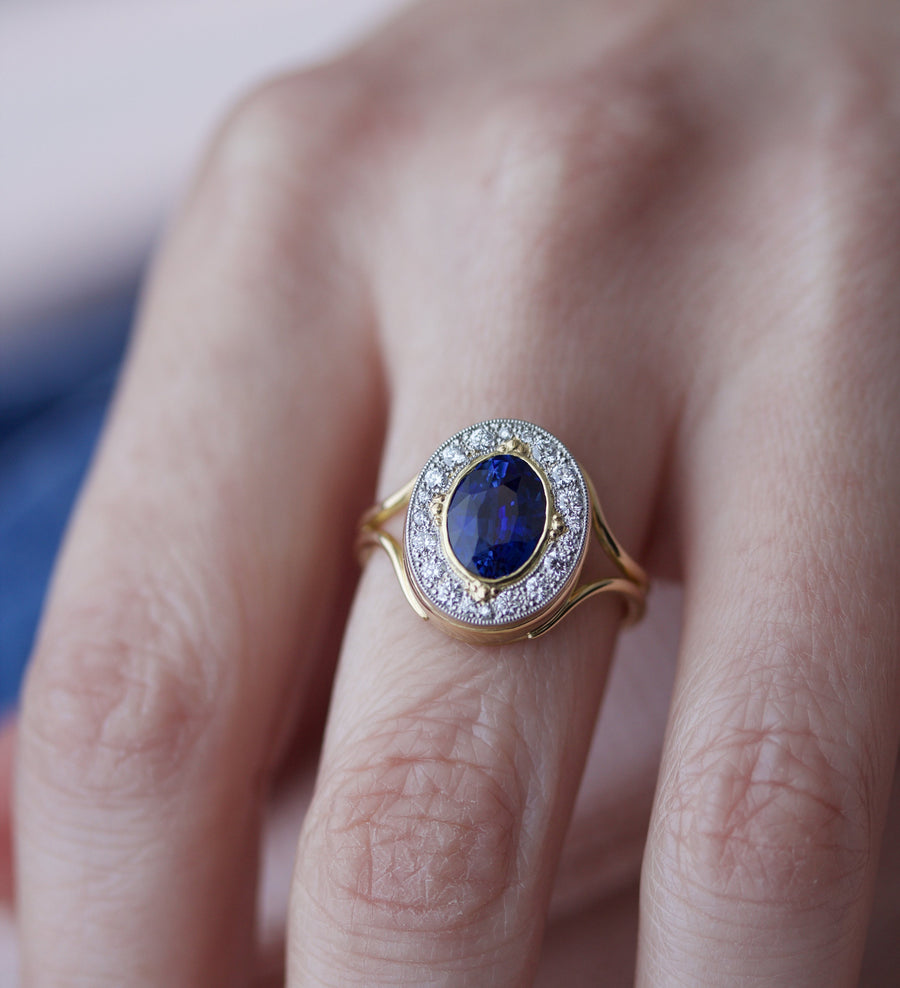 Blue Sapphire Ring with Surrounding Diamonds