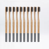 10-pack of 100% eco-friendly, biodegradable bamboo toothbrushes with soft black bristles and color-coded with dark gray detailing at the bottom