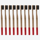 10-pack of 100% eco-friendly, biodegradable bamboo toothbrushes with soft black bristles and color-coded with hot pink detailing at the bottom