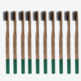 10-pack of 100% eco-friendly, biodegradable bamboo toothbrushes with soft black bristles and color-coded with forest green color detailing at the bottom