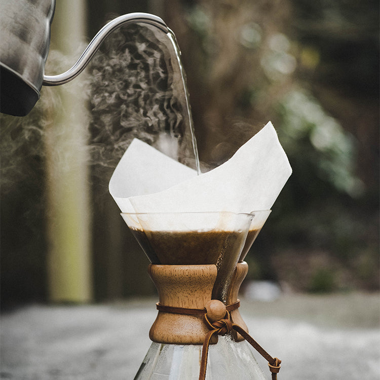 Freshly roasted carbon-offset coffee being brewed in a Chemex