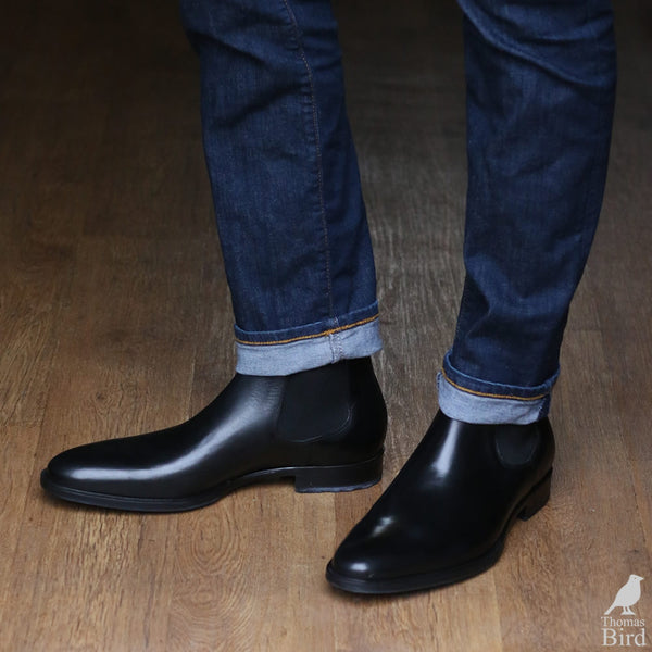 Black chelsea boots with blue jeans