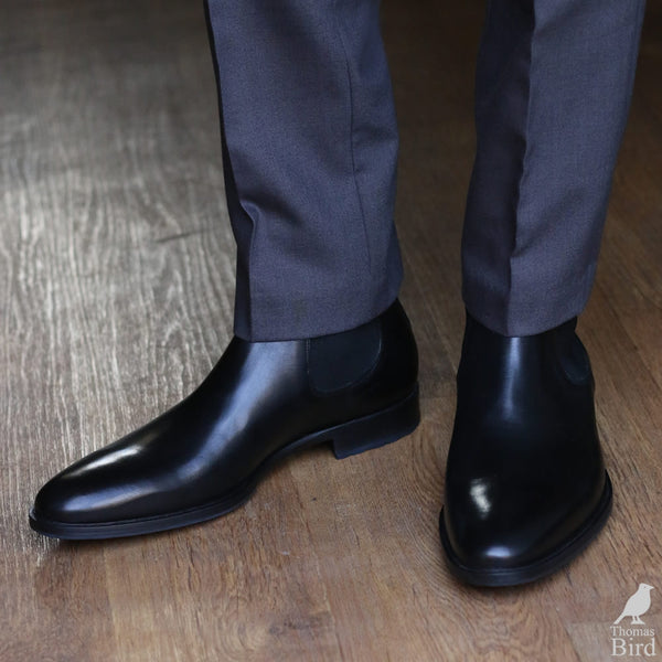 Black chelsea boots with grey suit trousers