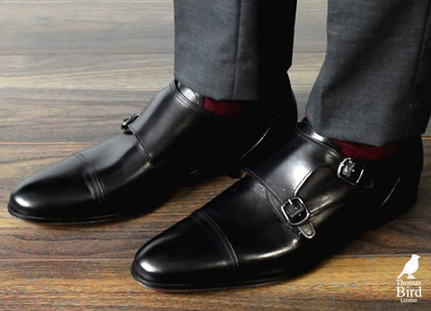 Black double monks with dark grey suit.