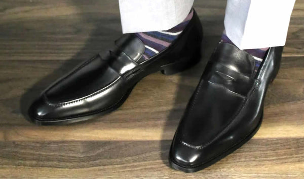Black penny loafers with socks
