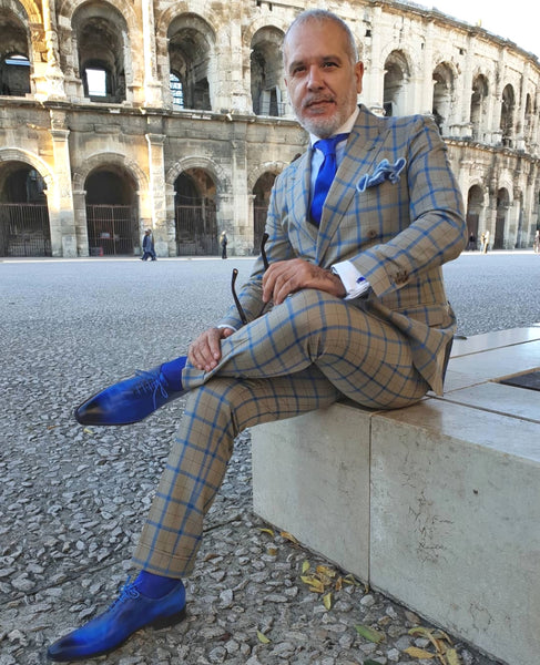 Suited Traveller wearing Thomas Bird custom blue wholecuts with a grey/blue windowpane suit