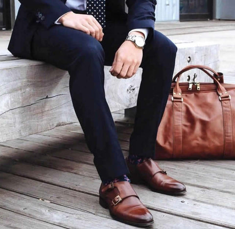 Tan monks with navy blue suit